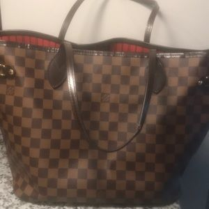 Louis Vuitton Neverfull MM tote and clutch